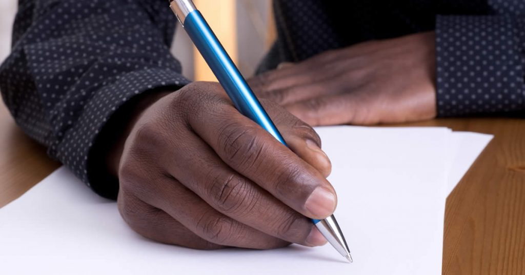 hands writing letter